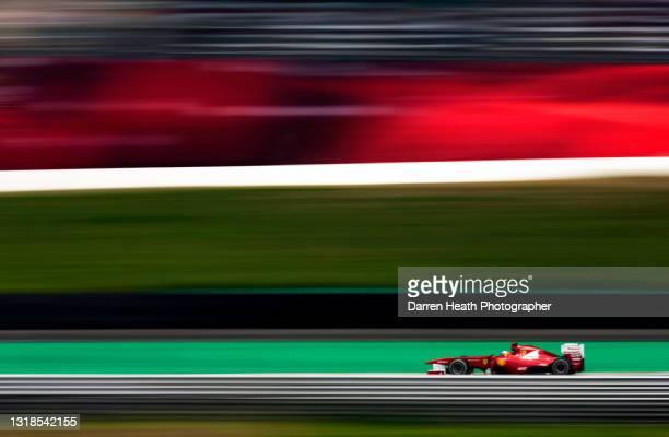 Spanish Scuderia Ferrari Formula One driver Fernando Alonso driving his Ferrari F150˚ Italia racing car at speed during practice for the 2011...
