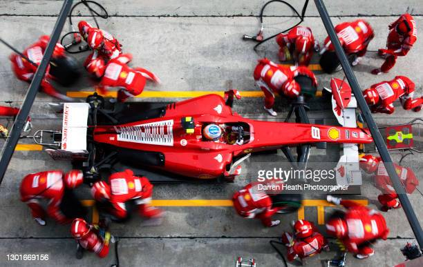 Spanish Scuderia Ferrari Formula One driver Fernando Alonso in his Ferrari F10 racing car during a pit stop for new tyres performed by Ferrari...