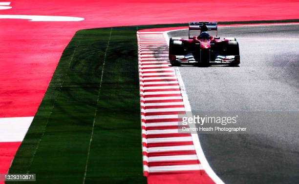 Spanish Scuderia Ferrari Formula One racing driver Fernando Alonso driving his F150˚ racing car during practice for the 2011 Spanish Grand Prix,...