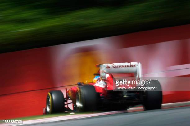 Spanish Scuderia Ferrari Formula One team racing driver Fernando Alonso driving his F2012 racing car at speed through Turn Four of the circuit during...