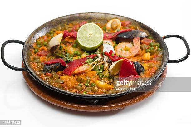 spanish seafood paella - paella stock photos and pictures