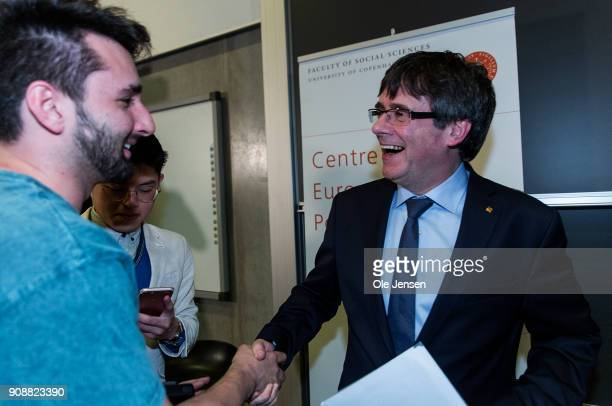 Spanish separatist leader Carles Puigdemont talks to audience at a conference at Copenhagen University during his first visit outside Belgium since...