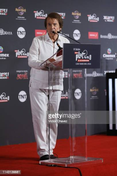 Spanish singer and actor Raphael speaks on stage during a ceremony to present the winner of the 2019 Platino honorary award before the 6th Platino...