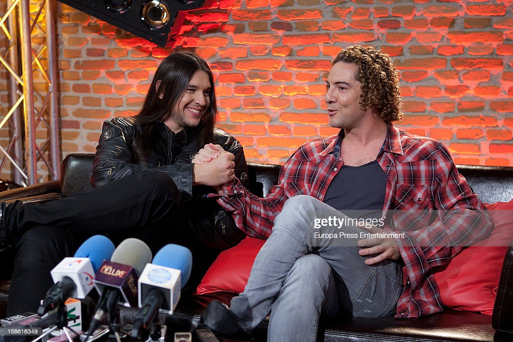 Spanish singer and coach David Bisbal (R) and winner Rafa Carpena of 'La Voz' Tv programme attend a press conference on December 20, 2012 in Madrid, Spain.