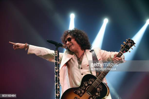 Spanish singer and composer Enrique Bunbury performs at the Palacio de los Deportes in Mexico City on February 22 2018 / AFP PHOTO / ALFREDO ESTRELLA