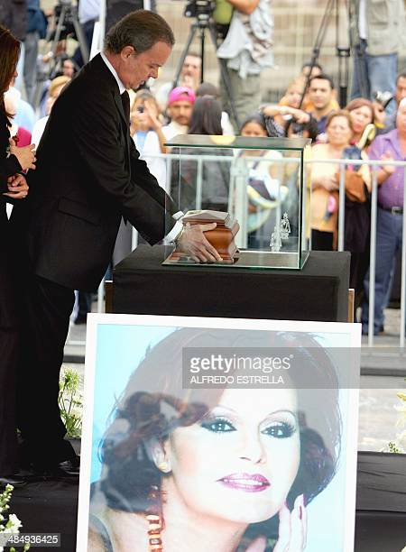 Spanish singer Antonio Morales Barretto aka Junior the widower of Spanish singer Rocio Durcal places the urn containing her ashes into a glass...