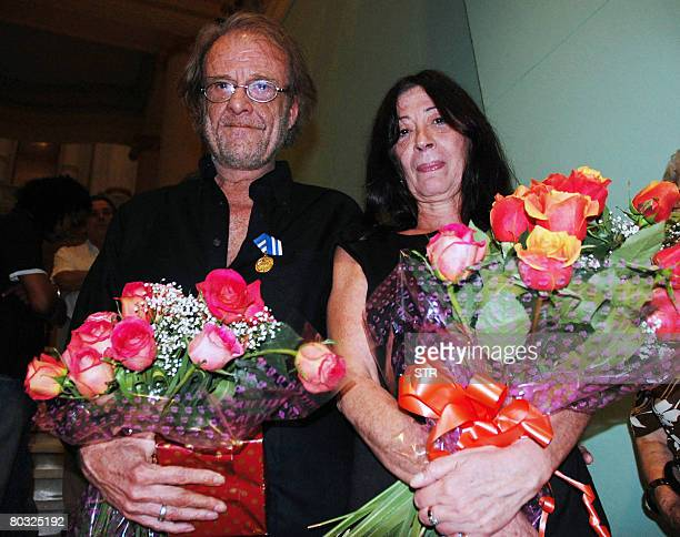 Spanish singer composer and painter Luis Eduardo Aute and his wife Maria del Carmen Rosado pose for a photo after being decorated with the...