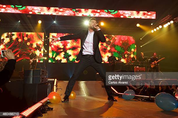 Spanish singer David Bisbal performs on stage at the Barclaycard Center on December 14 2014 in Madrid Spain