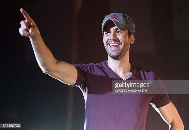 Spanish singer Enrique Iglesias performs on stage during a concert at the Wiener Stadthalle in Vienna on December 14 2016 / AFP / APA / GEORG...