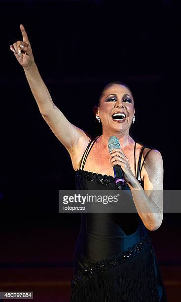 Spanish singer Isabel Pantoja performs on stage at the Palau de les Arts on June 8, 2014 in Valencia, Spain.