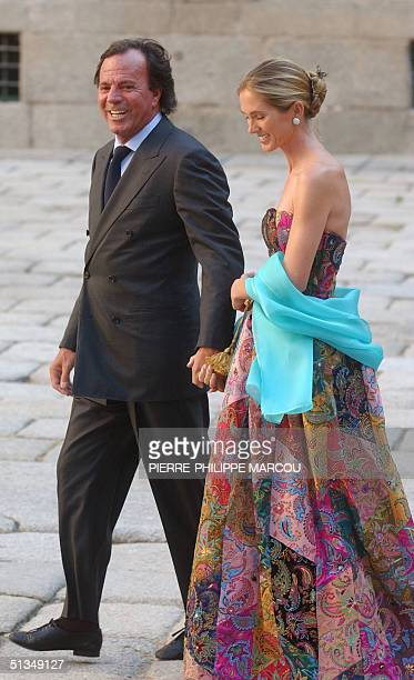 Spanish singer Julio Iglesias and his wife Miranda arrive for the wedding of Ana Aznar, daughter of Spanish Government chief Jose Maria Aznar with...
