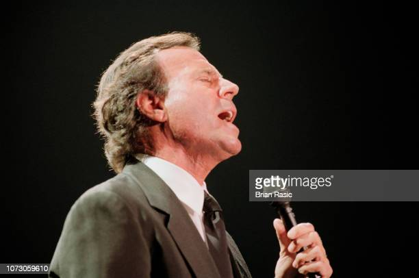 Spanish singer Julio Iglesias performs live on stage at Wembley Arena in London on 4th June 1995