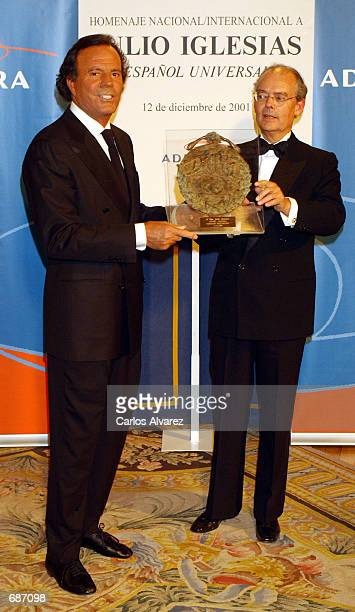 Spanish singer Julio Iglesias receives his Universal Spaniard Award from Ignacio Buqueras President of the Independent Foundation at the Ritz Hotel...