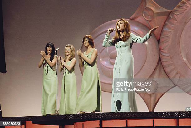 Spanish singer Karina performs the song 'En un mundo nuevo' on stage for Spain in the 1971 Eurovision Song Contest at the Gaiety Theatre in Dublin...