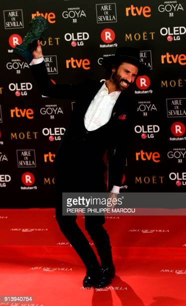 Spanish singer Leiva poses with the best original song award for 'La Llamada' at the 32nd Goya awards ceremony in Madrid on February 3 2018 / AFP...