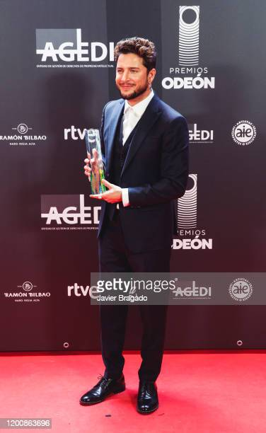 Spanish singer Manuel Carrasco winner of the Best Live Performance award poses in the trophy room during the 1st Odeon Awards at Teatro Real on...