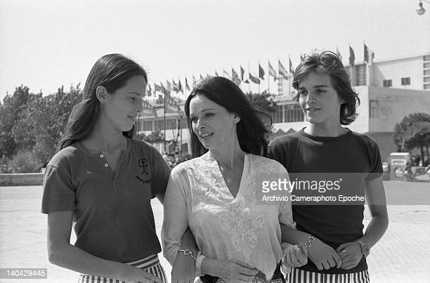 Spanish singer Miguel Bose with his mother Lucia Bose and his sister outside the Movie Palace, Lido, Venice, 1972.
