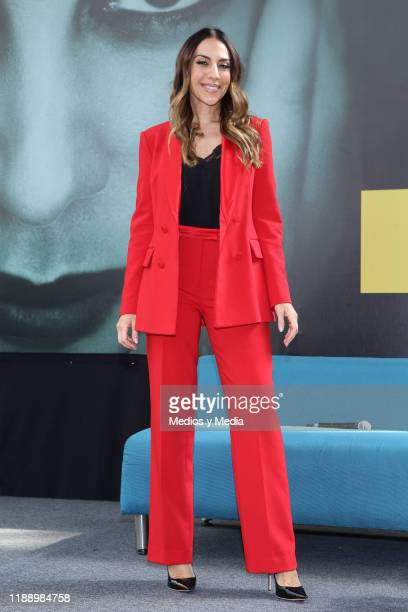 Spanish singer Monica Naranjo poses for photos at the end of a press conference on November 20 2019 in Mexico City Mexico