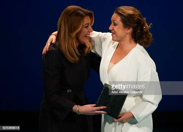 Spanish singer Nina Pastori receives the medal on hands of President of Andalusia Susana Diaz during the Medal of Andalucia awards 2018 at the Teatro...