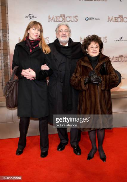 Spanish singer Placido Domingo and his wife Marta Ornelas arrive to the world premier of the film 'The Physician' at the 'UfaPalast am Zoo' cinema in...