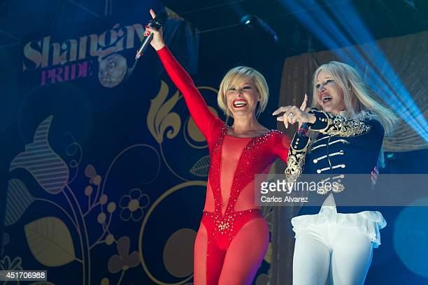 Spanish singer Soraya and Italian singer Spagna perform on stage during the Shangay Pride concert at the Vicente Calderon stadium on July 4 2014 in...