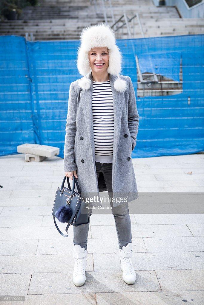 Spanish singer Soraya Arnelas wears Prada boots, H&M jeans and pullover, Zara coat, rabbit fur cap and Michael Kors handbag on January 22, 2017 in Madrid, Spain.