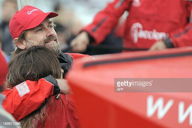 Spanish skipper Javier Sanso hugs his grilfriend Amal before the start of the 7th edition of the roundtheworld yacht race Vendee Globe on board his...
