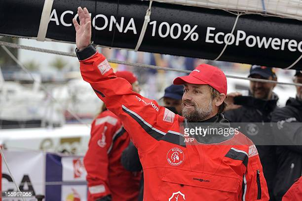 Spanish skipper Javier Sanso waves on board his monohull 'Acciona' before the start of the 7th edition of the Vendee Globe the solo nonstop...