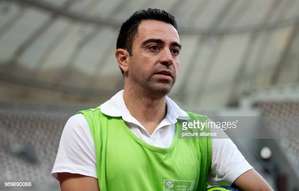 Spanish soccer player and ambassador for the 2022 FIFA World Cup Xavi Hernandez speaks during a press conference at the Khalifa International Stadium...