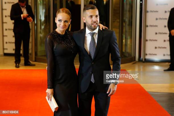 Spanish soccer player Jordi Alba and his girlfriend Romarey Ventura pose for pictures on the red carpet during Lionel Messi and Antonela Rocuzzo's...