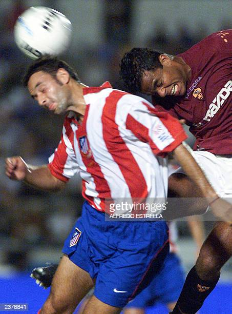 Spanish soccer player Jorge Larena of Atletico de Madrid fight for the ball against brazilian player Emerson Ferreira of Roma during their preseason...
