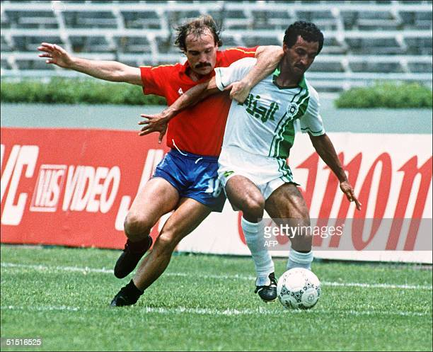 Spanish soccer player Ramon Caldere fights for the ball with Algeria's Kaci Said 12 June 1986 in Guadalajara during a World Cup soccer match between...