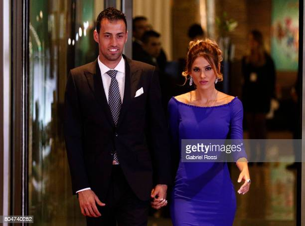 Spanish soccer player Sergio Busquets and his girlfriend Elena Galera pose for pictures on the red carpet during Lionel Messi and Antonela Rocuzzo's...