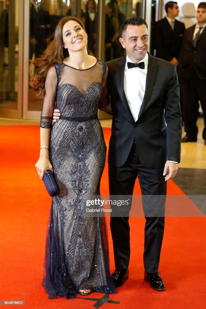 Spanish soccer player Xavi Hernández and his wife Nuria Cunillera pose for pictures on the red carpet during Lionel Messi and Antonela Rocuzzo's Wedding at City Center Hotel on June 30, 2017 in Rosario, Argentina.