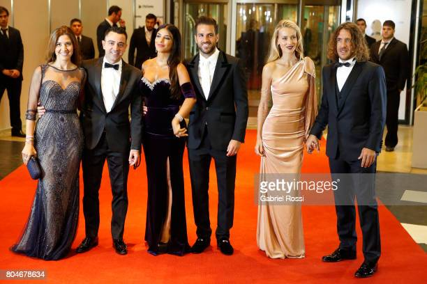 Spanish soccer player Xavi Hernández his wife Nuria Cunillera Spanish soccer player Cesc Fabregas and his wife Daniella Semaan Spanish former soccer...