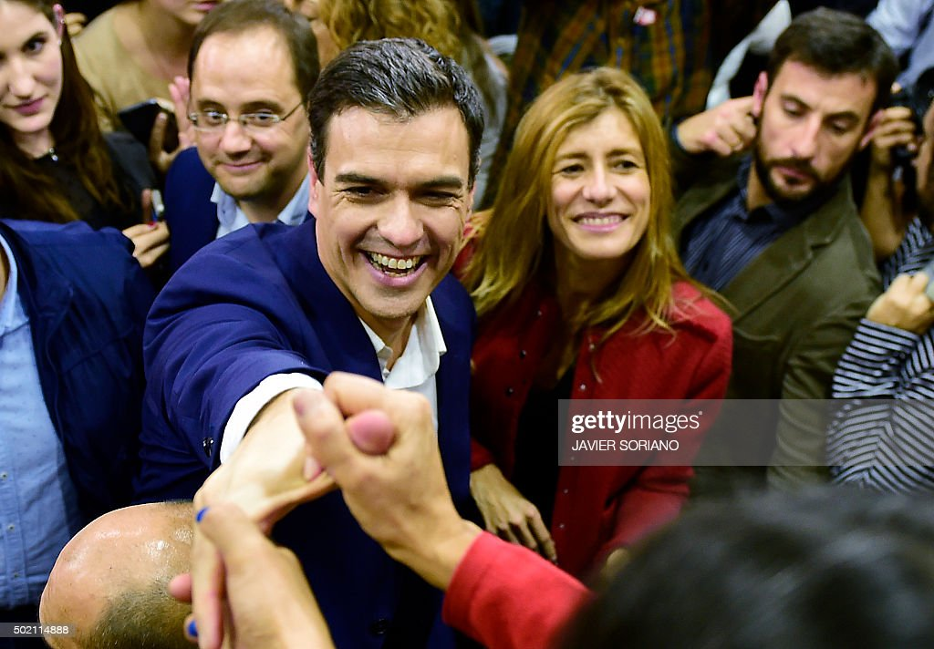 Spanish Socialist Party (PSOE) leader and candidate for the general elections, Pedro Sanchez (L) and his wife Begona Fernandez greet supporters after the partial results of Spain's general election in Madrid on December 20, 2015. Spain's ruling conservative Popular Party won the most seats in parliament in a general election Sunday but lost its absolute majority, partial results showed with over 80 percent of votes counted.