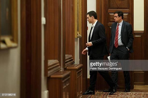 Spanish Socialist Party leader Pedro Sanchez and his party's spokesman Oscar Lopez walk along a corridor after his speech during a debate to form a...