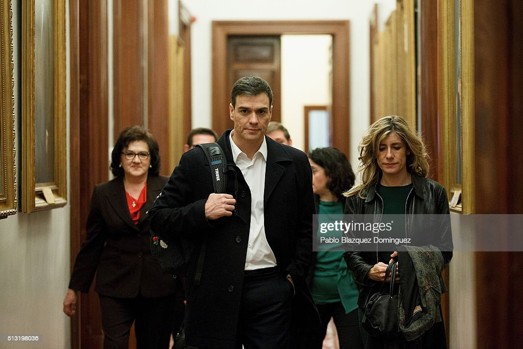 Spanish Socialist Party (PSOE) leader Pedro Sanchez (C) and his wife Begona Gomez (R) walk along a corridor after a debate to form a new government at the Spanish Parliament on March 1, 2016 in Madrid, Spain. The Spanish Socialist Party leader appeals for support ahead of the investiture debate to get enough votes from the other 349 deputies that would allow him to become Prime Minister. The Spanish political system requires Sanchez to achieve an overall majority in the vote, which follows the debate. If he fails to realise that in the first vote, a simple majority would be enough to make him Prime Minister in a second vote to be held 48 hours later.