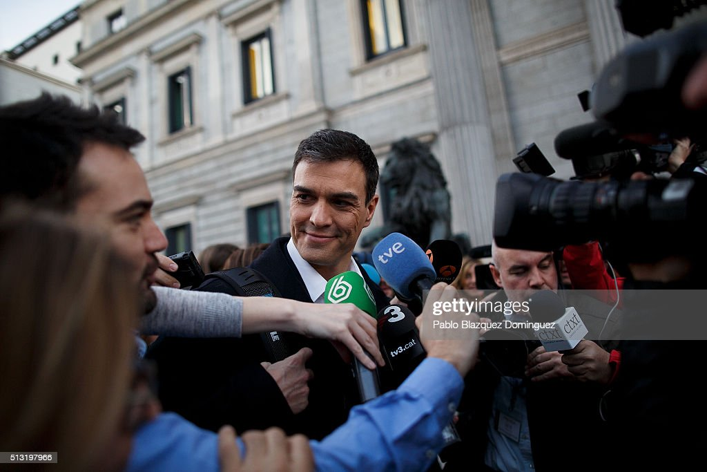 Spanish Socialist Party (PSOE) leader Pedro Sanchez speaks to the press as he walks in the street after his speech during a debate to form a new government outside the Spanish Parliament on March 1, 2016 in Madrid, Spain. The Spanish Socialist Party leader appeals for support ahead of the investiture debate to get enough votes from the other 349 deputies that would allow him to become Prime Minister. The Spanish political system requires Sanchez to achieve an overall majority in the vote, which follows the debate. If he fails to realise that in the first vote, a simple majority would be enough to make him Prime Minister in a second vote to be held 48 hours later.