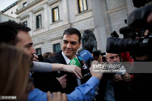 Spanish Socialist Party leader Pedro Sanchez speaks to the press as he walks in the street after his speech during a debate to form a new government...