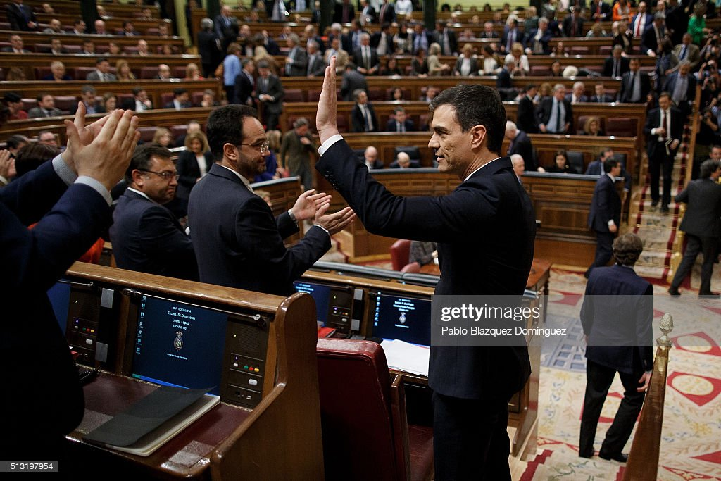 Spanish Socialist Party (PSOE) leader Pedro Sanchez (R) waves his hand to his party members after his speech during a debate to form a new government at the Spanish Parliament on March 1, 2016 in Madrid, Spain. The Spanish Socialist Party leader appeals for support ahead of the investiture debate to get enough votes from the other 349 deputies that would allow him to become Prime Minister. The Spanish political system requires Sanchez to achieve an overall majority in the vote, which follows the debate. If he fails to realise that in the first vote, a simple majority would be enough to make him Prime Minister in a second vote to be held 48 hours later.