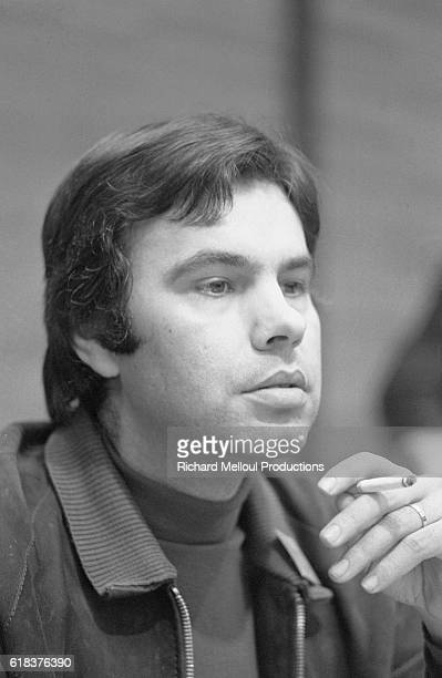 Spanish Socialist politician Felipe Gonzalez smokes a cigarette during a summit of southern European Socialists