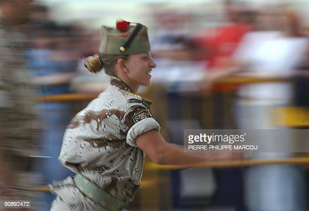 Spanish soldier from the last contingent to leave Iraq runs to take her place after arriving at the Torrejon de Ardoz military base 24 May 2004 The...