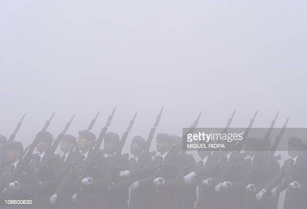 Spanish soldiers march under the fog at the Lavacolla airport of Santiago de Compostela on November 6 2010 as they wait for Pope Benedict XVI's...