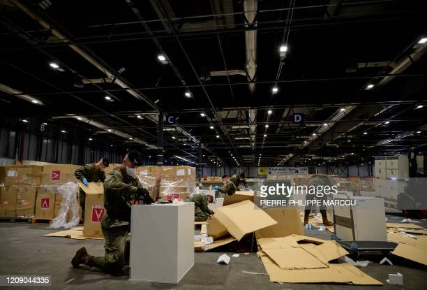 Spanish soldiers open boxes of medical aid at the Ifema convention and exhibition centre in Madrid on April 03 2020 where a temporary hospital for...