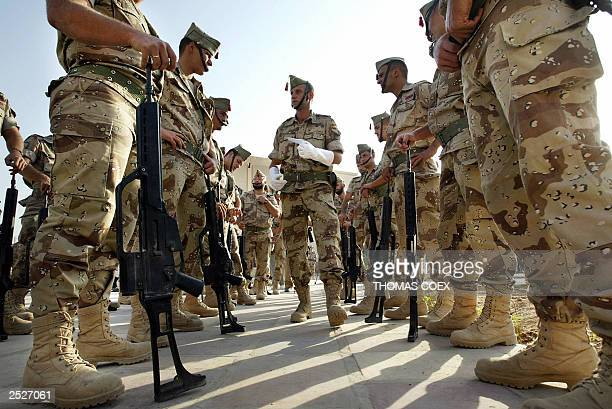 Spanish soldiers prepare their parade at the military headquarters in Najaf before an handover ceremony with US troops 23 September 2003 US marines...