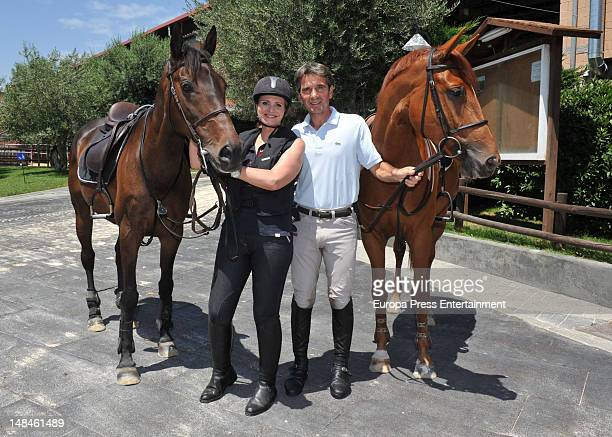 Spanish soprano Ainhoa Arteta and her husband the horseman Jesus Garmendia pose at Real Club de Polo de Barcelona on June 21 2012 in Barcelona Spain