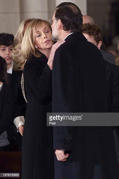 Spanish Spanish Prime Minister Mariano Rajoy greets Manuel Fraga's daughter Carmen Fraga as they attend the funeral mass of Manuel Fraga Iribarne...