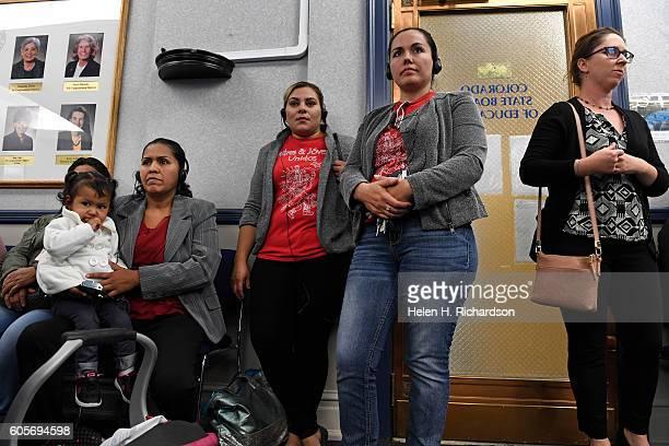 Spanish speaking parents Ana Munoz sitting with her 1 year old daughter Marianne Borras left Graciella Garcia second from left and Gloria Borunda...