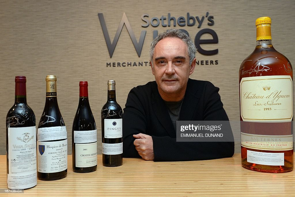 Spanish star chef Ferran Adria, of the award-winning restaurant elBulli, poses with signed wine bottles from the restaurant's wine cellar, in New York, April 25, 2013. Adria decided to permanently close his restaurant and put the entire content of elBullis wine cellar for auction, which is scheduled for April 26, 2013 at Sothebys. The proceeds will be used to sponsor his elBulli Foundation, aimed at preserving and celebrating the restaurants accomplishments, while keeping it as a center for gastronomic innovation. This new endeavour would allow him and his team the freedom to continue nurturing the creative drive that had defined elBulli, but without the restrictive timetable and demands of a restaurant. AFP PHOTO/Emmanuel Dunand / AFP / EMMANUEL